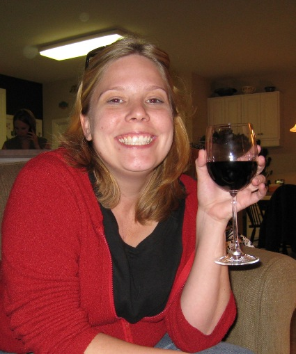 Amy enjoys a class of wine
