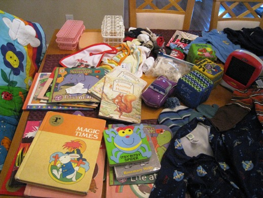 Books, bibs, toys, socks, dishwasher baskets, baby gym, safety equipment, hat with mittens
